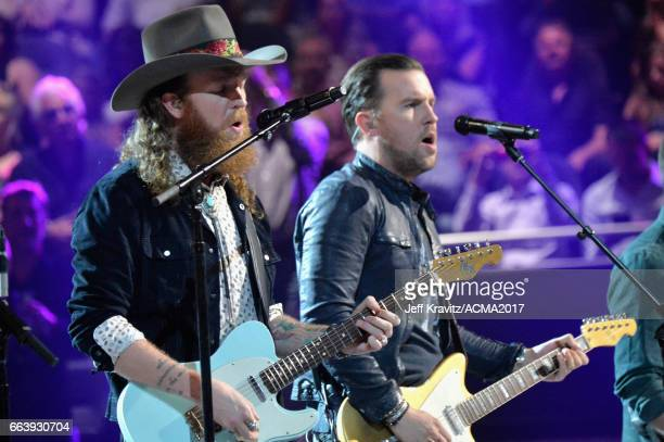 Music artists John Osborne and TJ Osborne of Brothers Osborne onstage at the 52nd Academy Of Country Music Awards at TMobile Arena on April 2 2017 in...