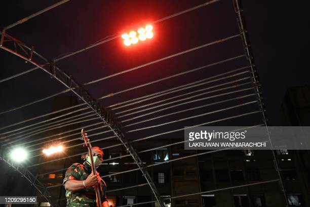 A music band formed by Sri Lankan Army personnel play outside a housing complex during a governmentimposed nationwide lockdown as a preventive...