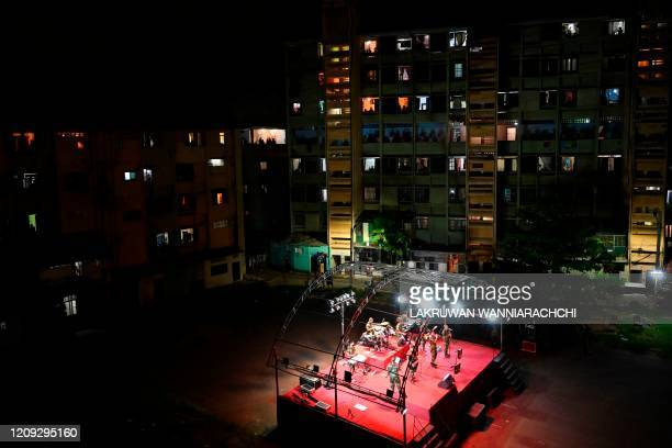 TOPSHOT A music band formed by Sri Lankan Army personnel play outside a housing complex during a governmentimposed nationwide lockdown as a...