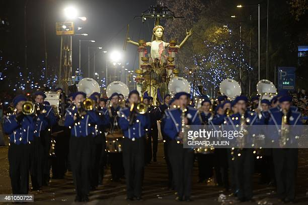 A music band perform followed by a float during the Three Kings parade in Madrid on January 5 2015 Every year on January 5 children and parents can...
