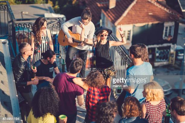 music band performing on party - martin guitar stock photos and pictures