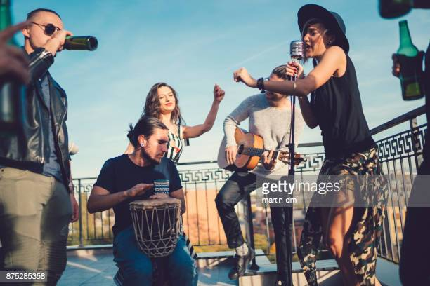 music band performing on the rooftop - performance group stock pictures, royalty-free photos & images