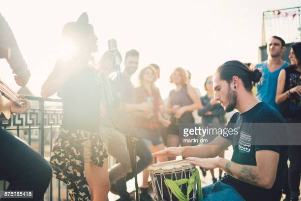 music band performing on the rooftop - percussion instrument stock photos and pictures