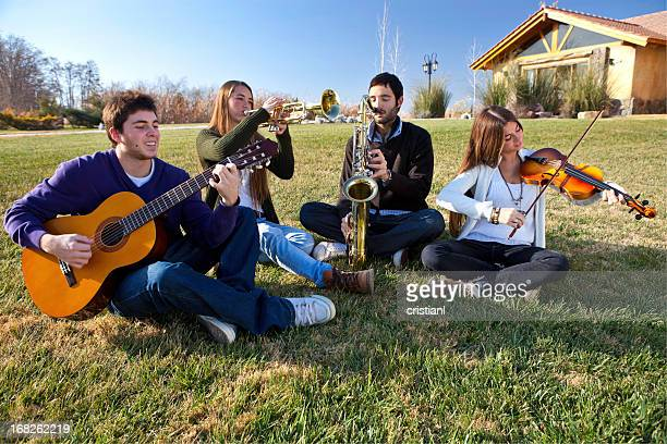 music band - musical quartet stock photos and pictures