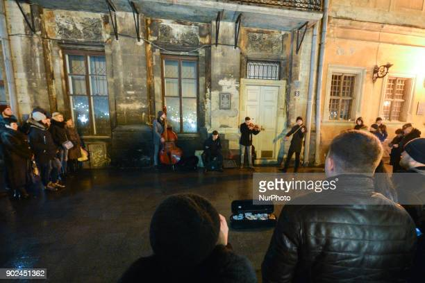 A music band plays Christmas melodies at the Rynek Square on Orthodox Christmas Day On Sunday 7 January 2018 in Lviv Ukraine