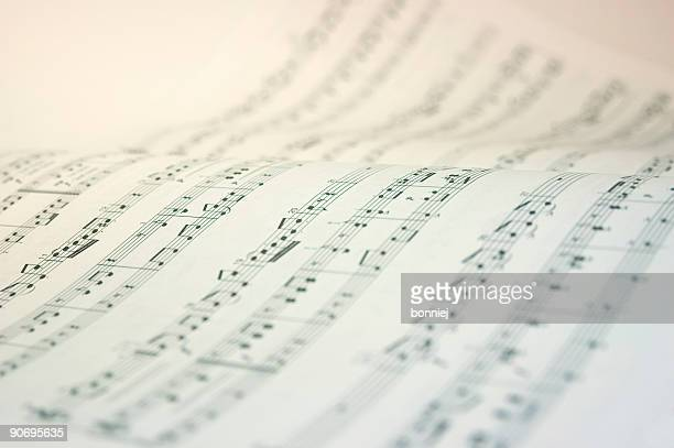 a music book open with music notes in black and white - muziek stockfoto's en -beelden