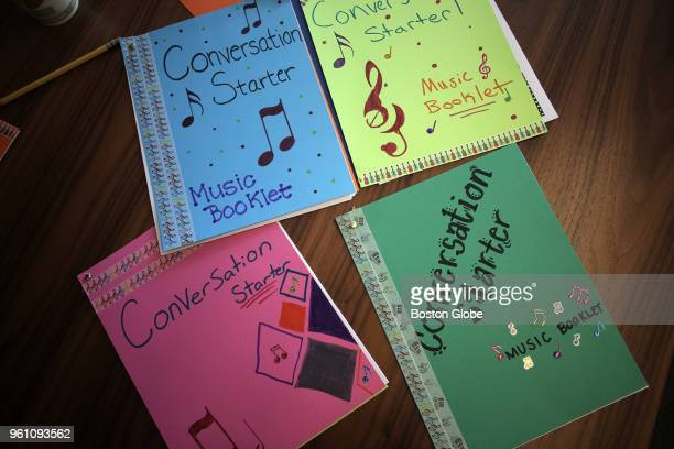 Music booklets worked on by JLL employees as part of a letter exchange program with the Boston Children's Chorus are pictured in Boston on May 3 2018...