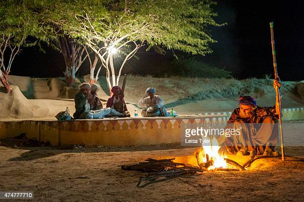 HODKA/ BANNI BHUJ GUJARAT INDIA Music by the fire at Shaam E Sarhad Village Resort an agrotourism project set up by India's Ministry of Tourism and...
