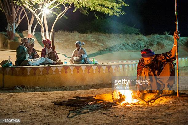 HODKA/ BANNI GUJARAT INDIA Music by the fire at Shaam E Sarhad Village Resort an agrotourism project set up by India's Ministry of Tourism and the...