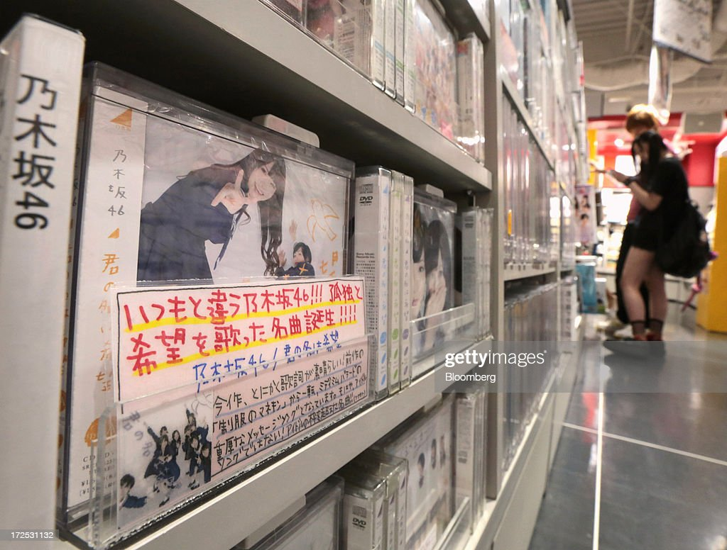 Music CDs and DVDs by 'Nogizaka 46', a Japanese girl group, are displayed on a shelf at a Tower Records Japan Inc. store in Tokyo, Japan, on Monday, July 1, 2013. Music sales in the country rose for the first time in five years, led by tunes delivered on CDs and other physical media, bucking the trend in developed markets as cheaper downloads gain ground. Physical media made up 82 percent of Japanese music sales last year, versus 37 percent in the U.S., said the Recording Industry Association of Japan. Photographer: Yuriko Nakao/Bloomberg via Getty Images