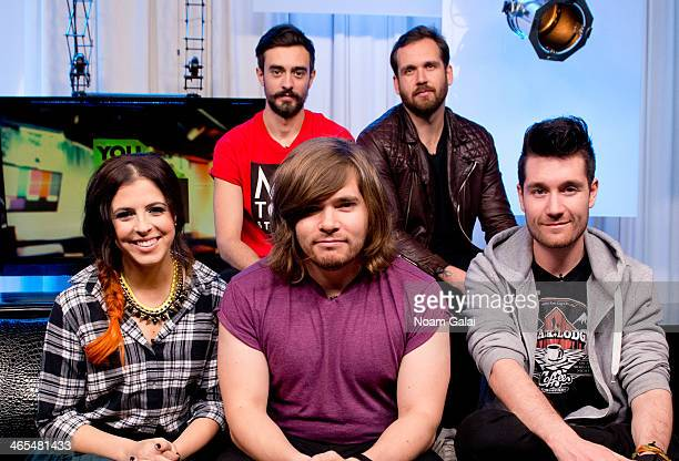 Music Choice 'You A' host Clare Galterio poses with Chris Wood Kyle Simmons Will Farquarson and Dan Smith of band Bastille at Music Choice on January...
