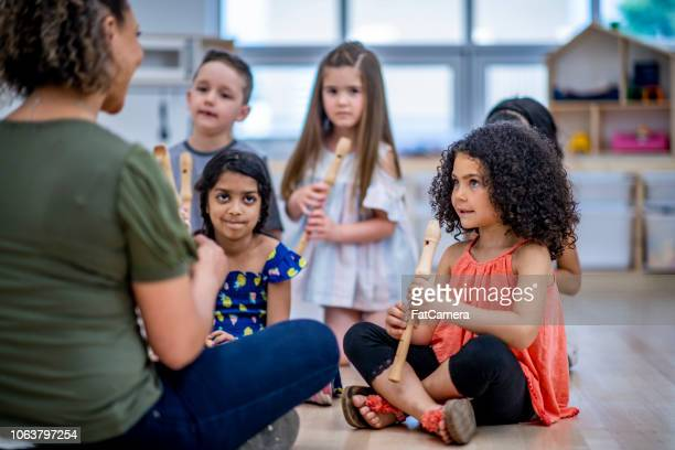 music class in daycare - recorder musical instrument stock photos and pictures