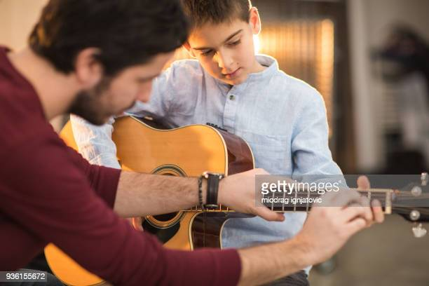music class is fun - acoustic guitar stock pictures, royalty-free photos & images
