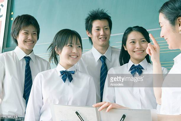 a music class - hot teacher stock pictures, royalty-free photos & images