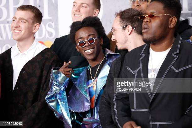 US music collective 'Brockhampton' pose on the red carpet on arrival for the BRIT Awards 2019 in London on February 20 2019 / RESTRICTED TO EDITORIAL...