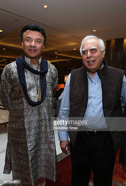 Music composer Anu Malik with Congress leader Kapil Sibal during prewedding party of singer Daler Mehndi's daughter Ajit Kaur with Navraj Singh son...