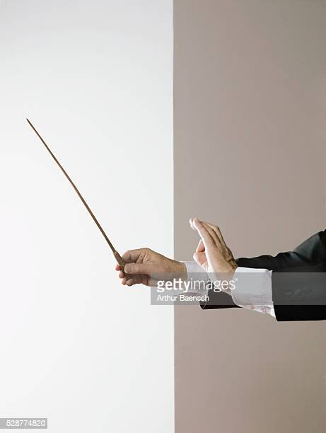 music conductor - conductor's baton stock photos and pictures