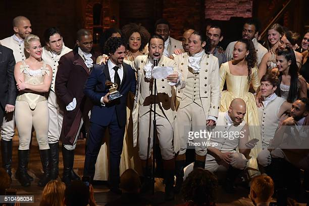 Music director Alex Lacamoire actor composer LinManuel Miranda and cast of Hamilton celebrate on stage during Hamilton GRAMMY performance for The...