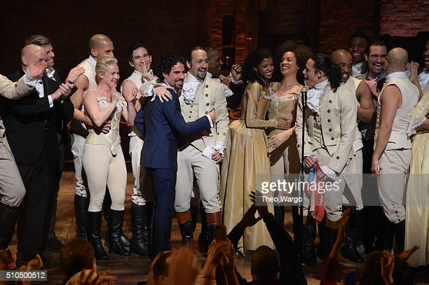 """Music director Alex Lacamoire and actor, composer Lin-Manuel Miranda and cast of """"Hamilton"""" celebrate on stage the receiving of GRAMMY award after..."""