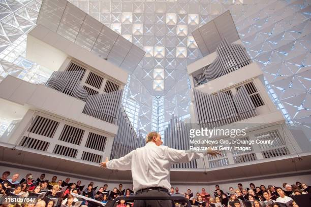 Music director John Romeri center leads the Christ Cathedral Choir in rehearsal at of Christ Cathedral in Garden Grove on Monday July 8 2019 as they...