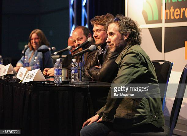 """Music editor Shirley Halperin, Charles Chavez of Latium Entertainment, Esquire's Andy Langer and musician Taylor Hanson speak onstage at """"When to..."""