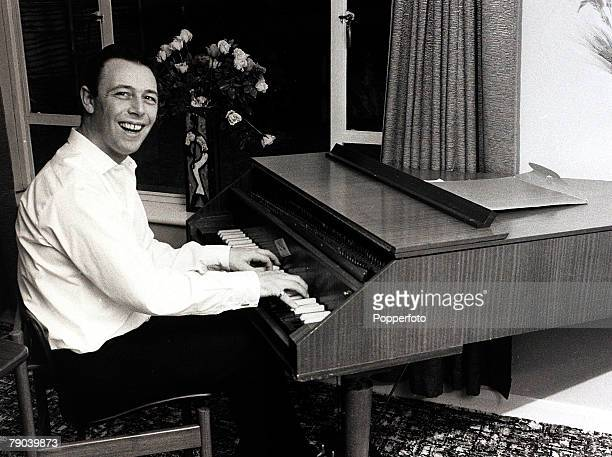 Music, England, 7th October 1967, Pop composer Les Reed pictured at work composing on a harpsichord previously owned by Beatle John Lennon
