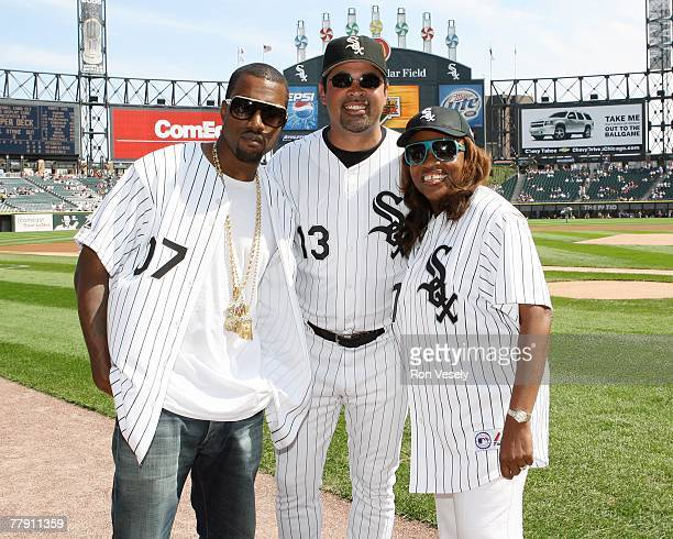 Music entertainer Kanye West and his mother Donda West pose for a photo with manager Ozzie Guillen of the Chicago White Sox prior to the White Sox...