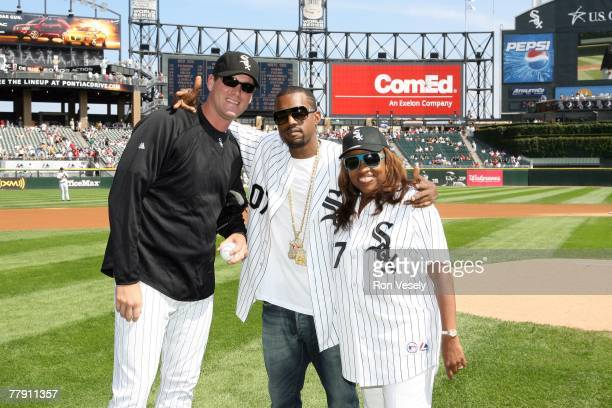 Music entertainer Kanye West and his mother Donda West pose with Matt Thornton of the Chicago White Sox after Donda threw out a ceremonial first...