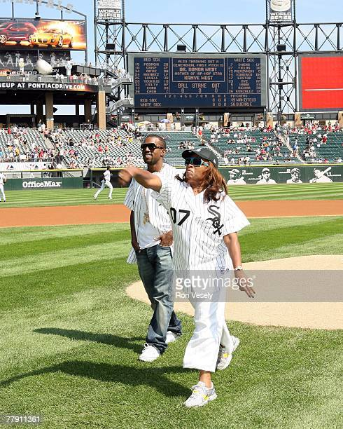 Music entertainer Kanye West and his mother Donda West throw out a ceremonial first pitch prior to the White Sox game at US Cellular Field in Chicago...