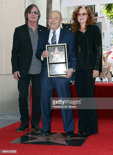 Music executive Joe Smith is honored with a Star on the Hollywood Walk of Fame and poses with Jackson Browne and Bonnie Raitt during the installation...