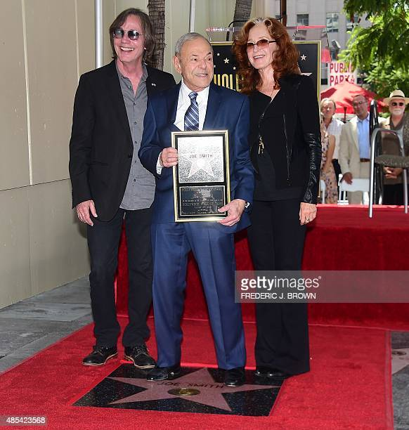 Music executive Joe Smith poses with musicians Jackson Brown and Bonnie Raitt during his Hollywood Walk of Fame Star ceremony in Hollywood California...