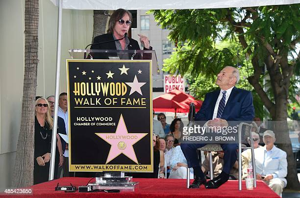 Music executive Joe Smith watches as musician Jackson Brown addresses the audience during Smith's Hollywood Walk of Fame Star ceremony in Hollywood...