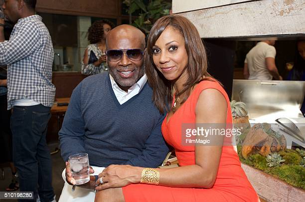 Music Executive LA Reid and Actress Holly Robinson Peete pose for a photo at the LA Reid 'Sing To Me' PreGrammy Brunch at Hinoki The Bird on February...