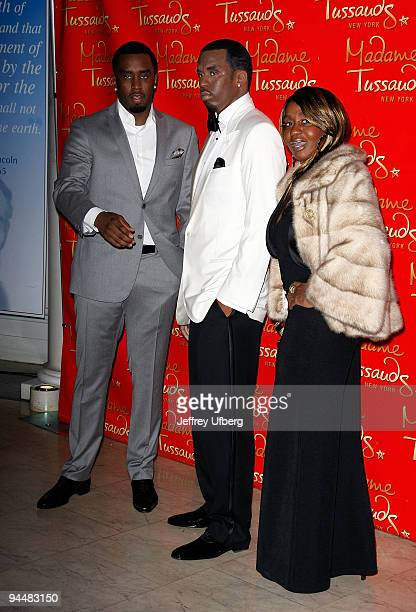 Music Executive Sean Diddy Combs and Janice Combs attend the Sean Combs wax figure unveiling>> at Madame Tussauds on December 15 2009 in New York City