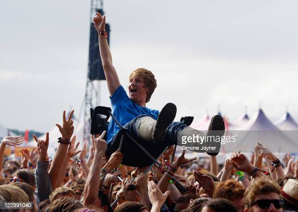 Music fan crowd surfs on a camping chair as The View performs live on the Main Stage during day three of Reading Festival 2011 on August 28, 2011 in...