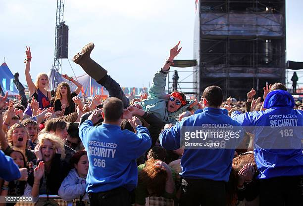 A music fan crowd surfs towards the safety stewards as You Me At Six perform live on the Main stage during the third and final day of Reading...