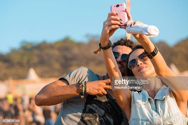 Music fan doing a photo selfie during the third day of the Tomorrowland music festival at Parque Maeda Itu on April 23 2016 in Sao Paulo Brazil