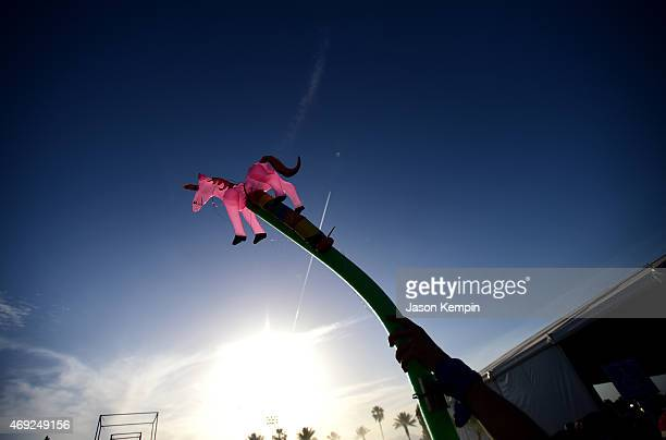A music fan holds up an inflatable unicorn during day 1 of the 2015 Coachella Valley Music Arts Festival at the Empire Polo Club on April 10 2015 in...