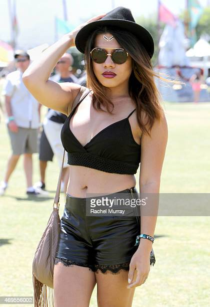 Music fan Jacky Manago wearing Chanel sunglasses and foil gold tattoos attends the 2015 Coachella Valley Music and Arts Festival Weekend 1 at The...
