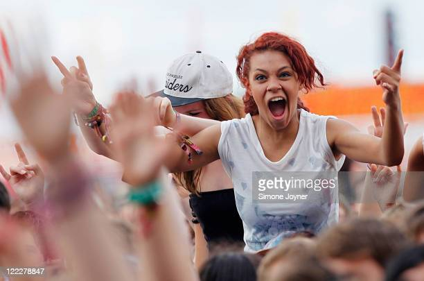 A music fan soaks up the atmosphere as Two Door Cinema Club perform live on the Main Stage during day two of Reading Festival 2011 on August 27 2011...