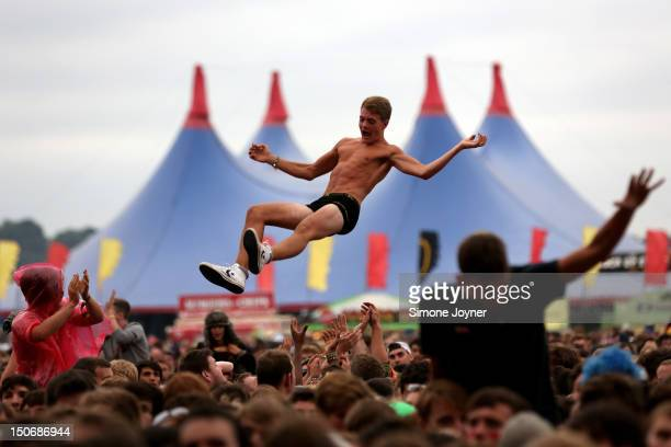 Music fan soaks up the atmosphere as You Me At Six performs live on the Main Stage during Day One of Reading Festival 2012 at Richfield Avenue on...