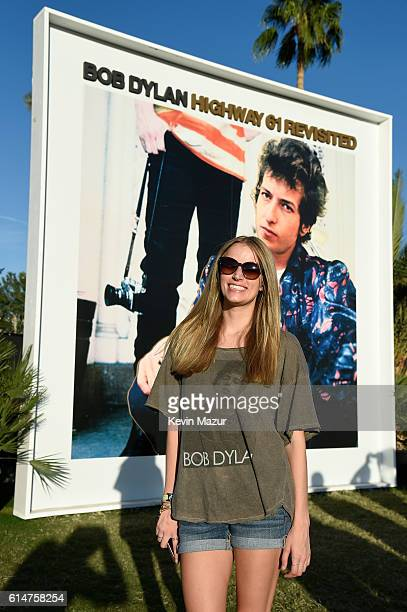Music fan wearing a Bob Dylan Tshirt poses in front of the Bob Dylan 'Highway 61 Revisited' album cover displayed on the grounds at Desert Trip at...