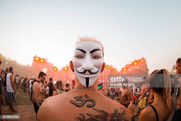 Music fan with V for Vendetta mask during the third day of the Tomorrowland music festival at Parque Maeda Itu on April 23 2016 in Sao Paulo Brazil
