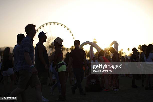 Music fans are seen at the Coachella Valley Music Arts Festival at the Empire Polo Club in Indio California April 13 2014 The annual music festival...