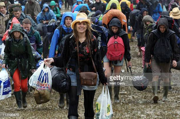 Music fans arrive in the mud and the rain at the Glastonbury Festival site at Worthy Farm, Pilton on June 22, 2011 in Glastonbury, England. Heavy...