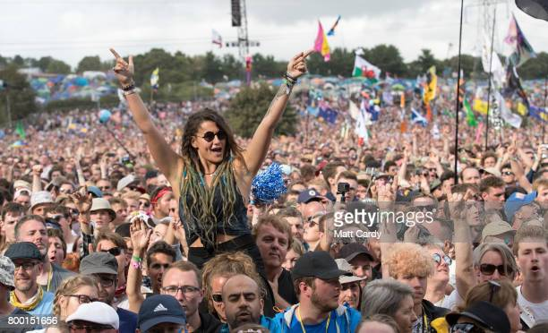 Music fans cheer as Royal Blood on the Pyramid Stage at the Glastonbury Festival site at Worthy Farm in Pilton on June 23 2017 near Glastonbury...