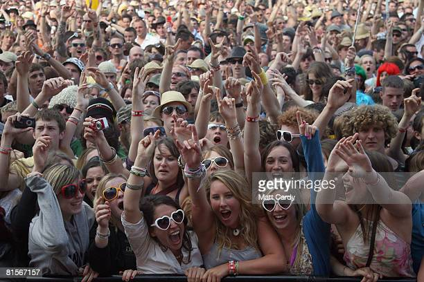 Music fans cheer while watching The Enemy perform on stage during the Isle of Wight Festival at Newport on June 14 2008 in the Isle of Wight England...