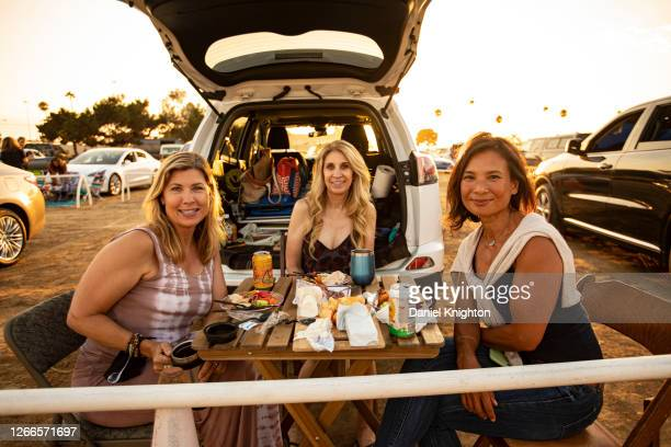Music fans Christine Howard, Melinda Peters, and Judy Loe attend a Chords & Cars Drive-In Concert at Del Mar Fairgrounds on August 15, 2020 in Del...