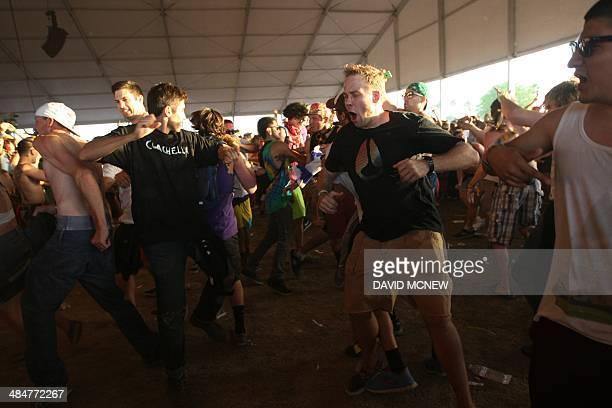 Music fans dance at the Coachella Valley Music Arts Festival at the Empire Polo Club in Indio California April 13 2014 The annual music festival...