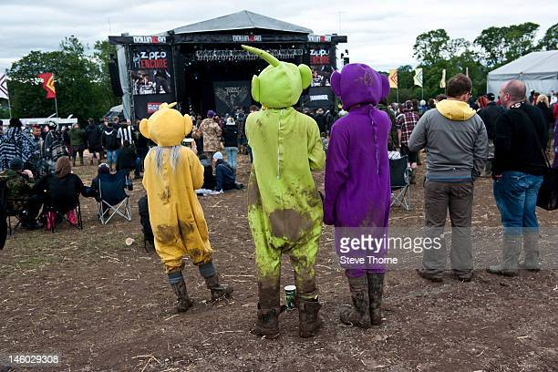 Music fans dress as teletubbies during Download Festival at Donington Park on June 9 2012 in Castle Donington United Kingdom